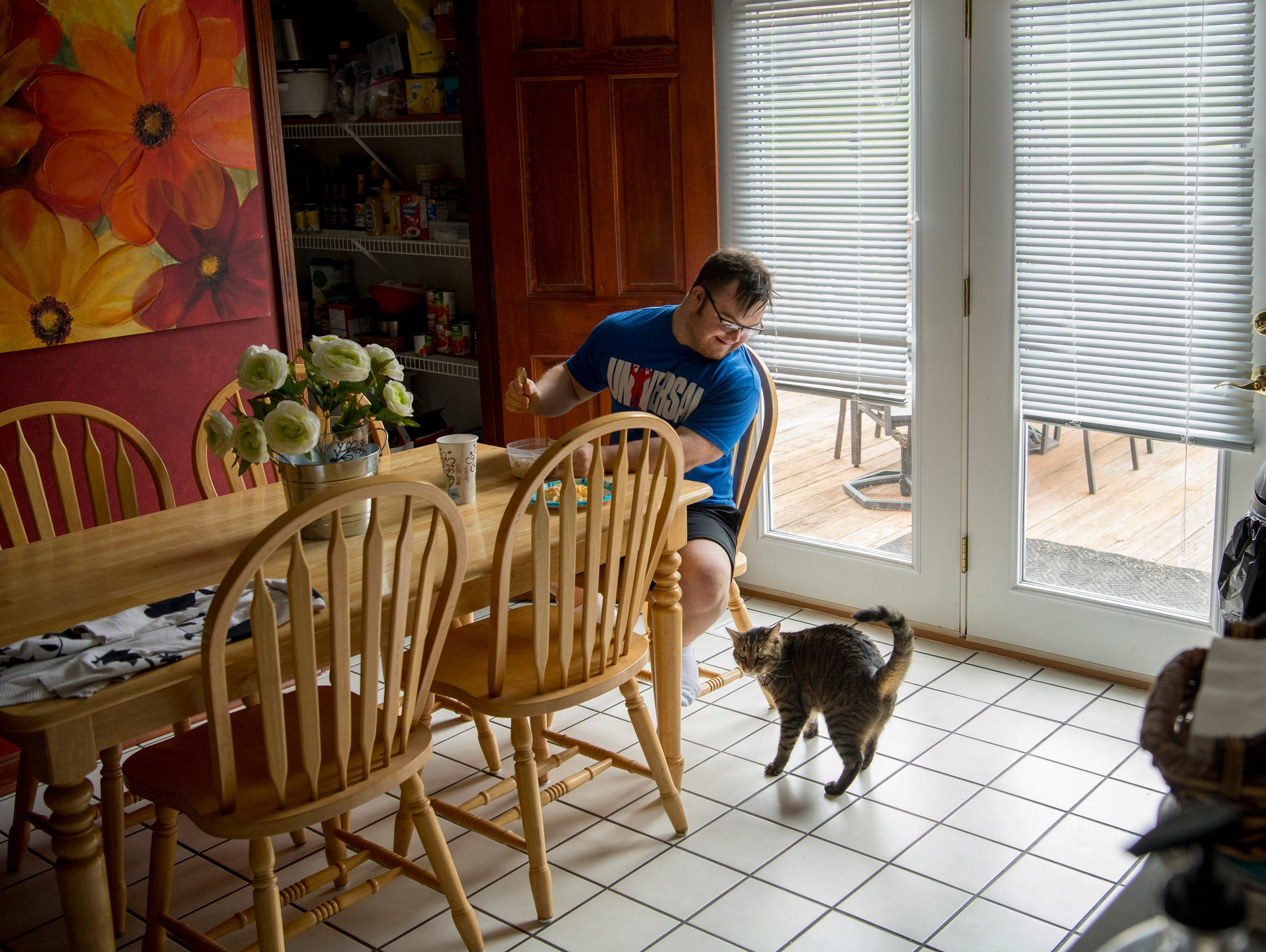 With his cat, Spidey, his only company, Collin sits