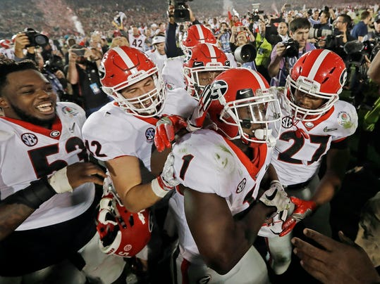 FILE - In this Monday, Jan. 1, 2018, file photo ,Georgia tailback Sony Michel (1) celebrates with teammates after scoring the game-winning touchdown in the second overtime period to give Georgia a 54-48 win over Oklahoma in the Rose Bowl NCAA college football game in Pasadena, Calif. Georgia coach Kirby Smart is concerned the emotional drain from the Rose Bowl playoff semifinal win over Oklahoma could affect his team's ability to regroup for the national championship game against Alabama.  (AP Photo/Doug Benc, File)