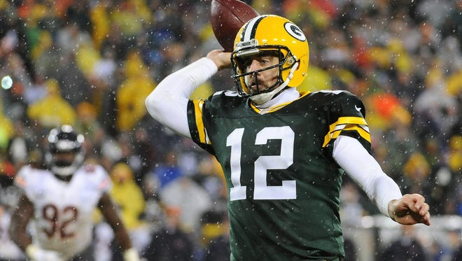 Green Bay Packers quarterback Aaron Rodgers (12) throws in the fourth quarter against the Chicago Bears at Lambeau Field.