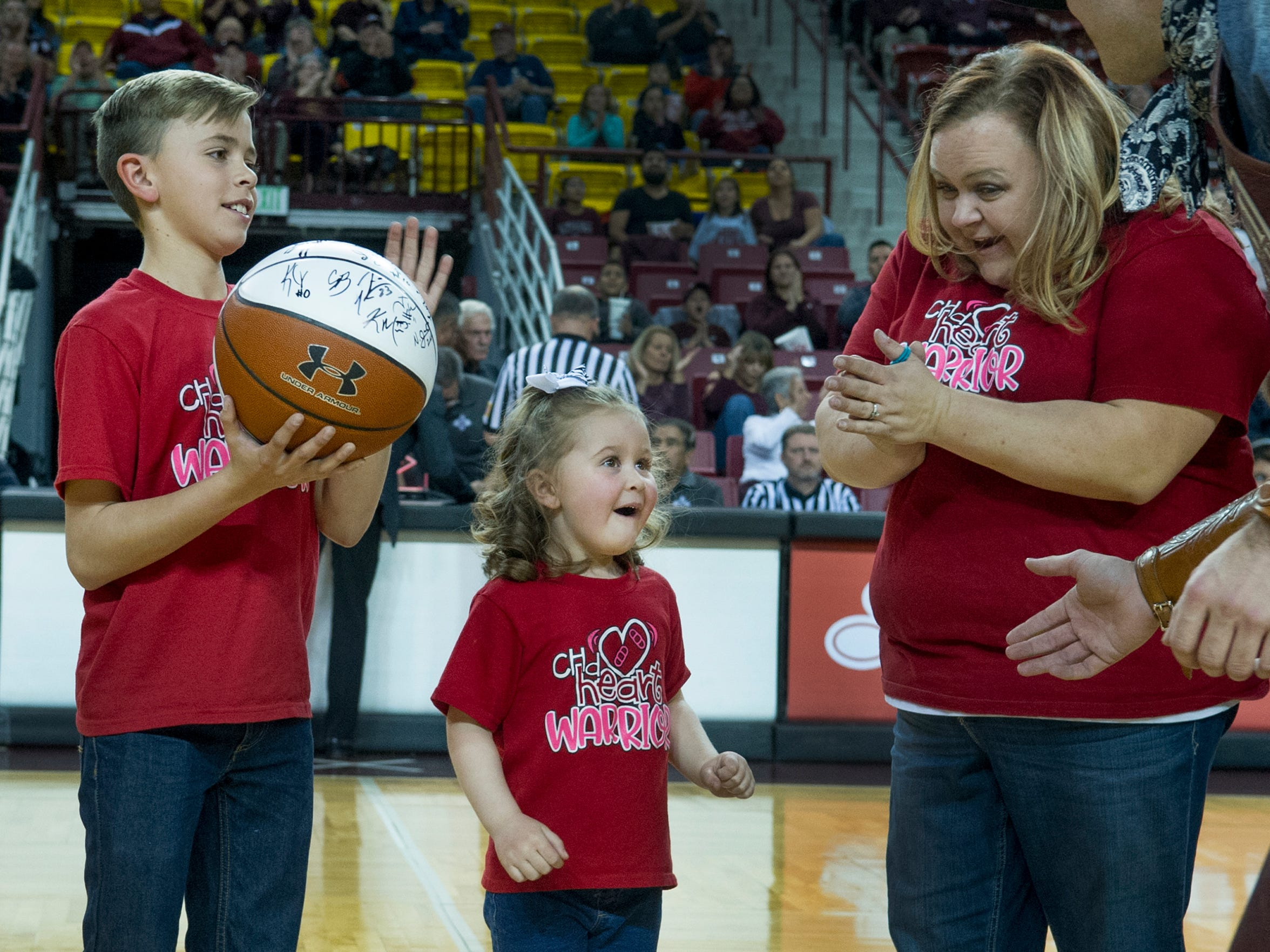 Ashley Maki, right, claps for her daughter, Kayla Maki, 5, on Tuesday, Jan. 30, 2018, at the Pan American Center in Las Cruces. Kayla, who has a serious heart condition, just learned a wish submitted to Make-a-Wish New Mexico will be granted. Her older brother, Ethan Maki, 13, looks on.