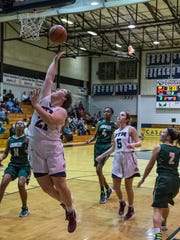 St. Thomas More's Bailey Hemphill with the put back shot as the St. Thomas More girls basketball team play Crowley High on Thursday Nov. 12, 2015.
