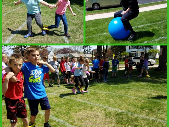 Students participate in St. Francis of Assisi School's field day May 18 on the elementary school campus.