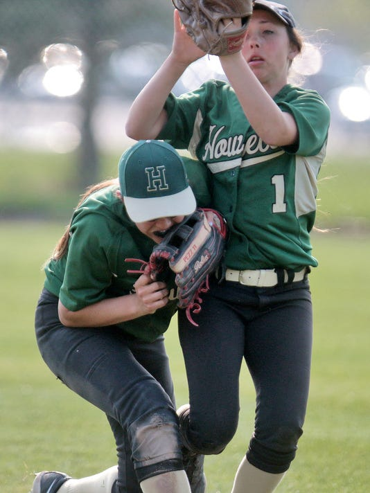 Howells Sydney Pezzonio holds onto the ball while coliding with teammate Ver.jpg