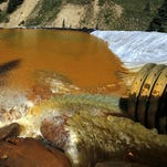 In this Aug. 14, 2015 file photo, water flows through a series of sediment retention ponds built to reduce heavy metal and chemical contaminants from the Gold King Mine wastewater accident, in the spillway about 1/4 mile downstream from the mine, outside Silverton, Colo. Southwestern Colorado residents told Congress Thursday, Oct. 1, 2015 that the Gold King Mine blowout and other mines spilling acid waste into waterways could cause serious long-term damage to their tourism economy, but they disagreed on whether a federal Superfund designation would help or hurt. (AP Photo/Brennan Linsley, file)