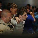 FILE - In this June 18, 2016, file photo, police remove protestor Michael Steven Sandford as Republican presidential candidate Donald Trump speaks at the Treasure Island hotel and casino in Las Vegas. Sandford, a British man accused of trying to take a police officer's gun and kill Donald Trump during a weekend rally in Las Vegas, will not be released on bail. Federal Magistrate Judge George Foley said at a hearing Monday that Sandford was a potential danger to the community and a flight risk. (AP Photo/John Locher, File)