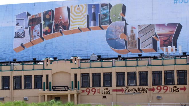This July 3, 2015 photo shows a billboard on the Atlantic City, N.J. Boardwalk. Despite the resort's financial woes, city officials insist visitors won't notice anything different this summer 2016, as its casinos, restaurants and other attractions will all be open as usual.