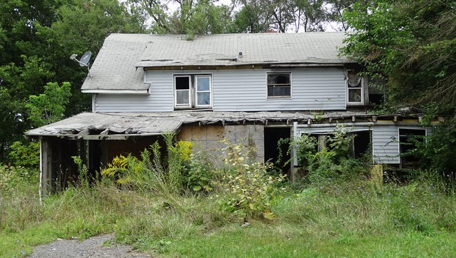 This home at 25 Copeland Avenue was foreclosed on after it was found the owners, who had died, owed about $11,000 in real estate taxes and assessments.