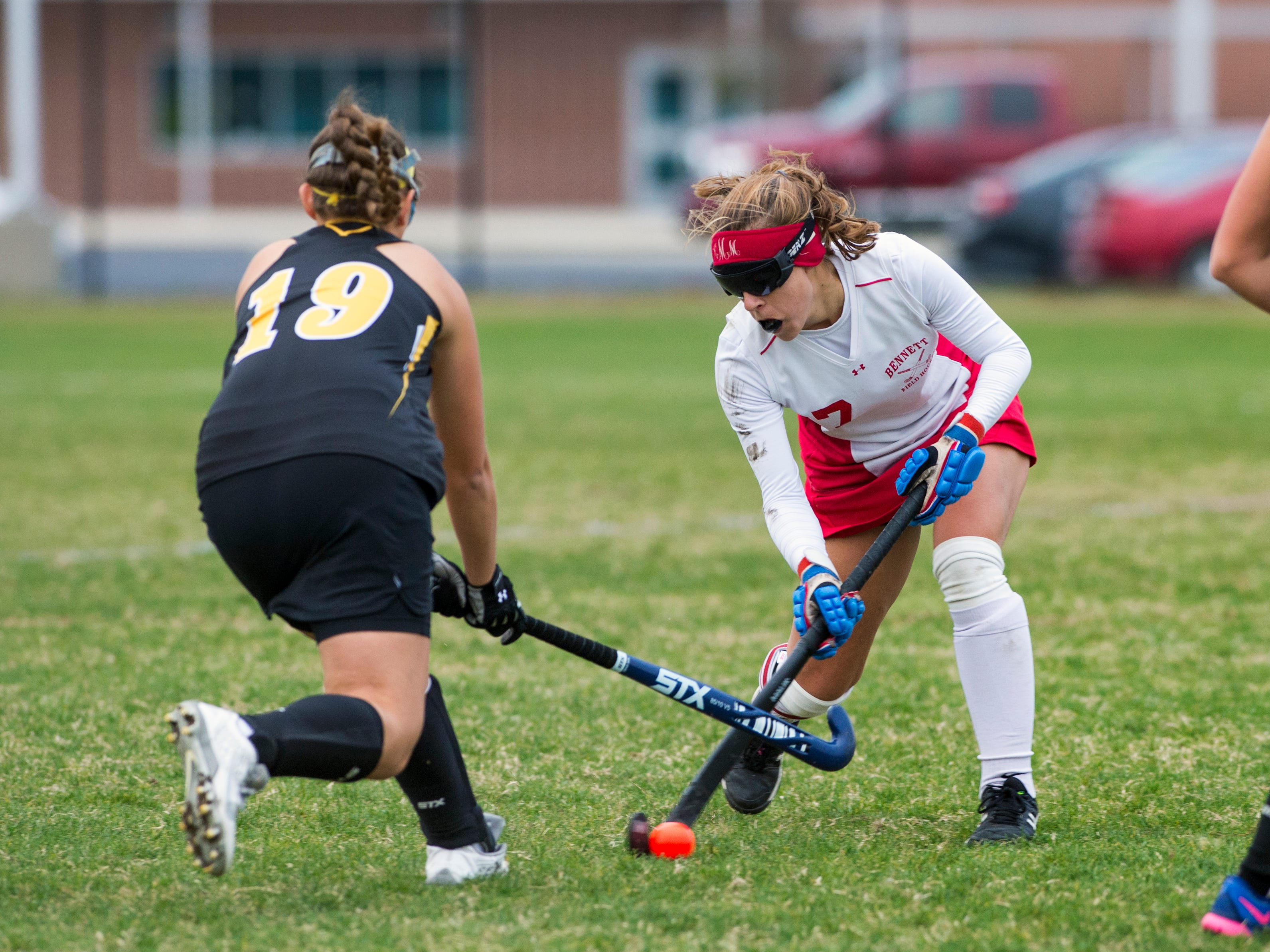 Bennett's #7 Keegan Marsh, right, moves the ball against Northeast's #19 Megan Carr during their playoff game Thursday.