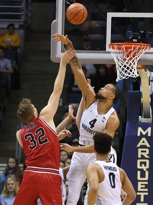 Marquette freshman Theo John rejects a shot against Northern Illinois on Monday.