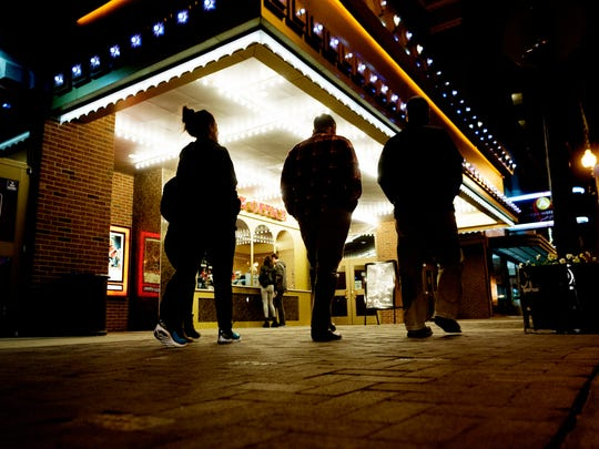 Patrons outside of the box office at the downtown Regal