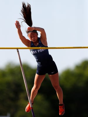 Olivia Mabry, of Bay Port, clears the bar during the pole vault at the WIAA Track and Field Championships Friday, June 2, 2017, at Veterans Memorial Field Sports Complex, in La Crosse, Wis.
