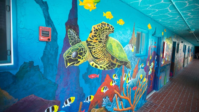 A mural in progress encompasses the second floor of the iconic Lani Kai hotel on Thursday, April 13 on Fort Myers Beach.