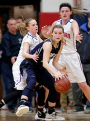 Appleton North High School's #20 Sydney Levy against Appleton West High School's #1 Maddie Vantassel, left, and #21 Zoey Zuleger during their WIAA sectional semifinal girls' basketball game on Thursday, March 2, 2017 at Appleton East High School in Appleton, Wis. Wm. Glasheen/USA TODAY NETWORK-Wisconsin