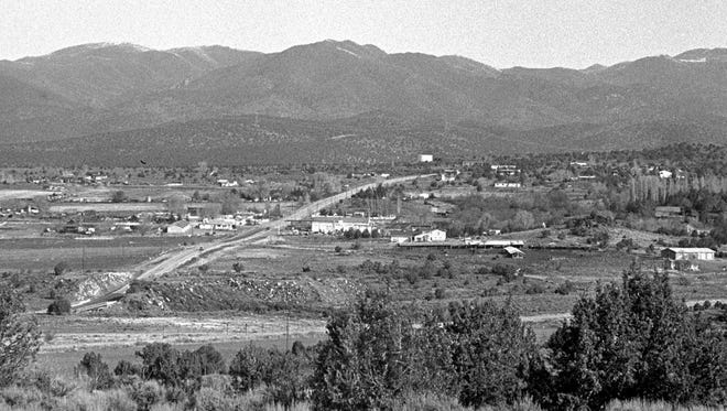 In March of 1992, Spectrum photographer Nancy Rhodes captured the then shot looking north over the town of Veyo. Nearly a quarter of a century later, the now image, taken by Spectrum photographer Jud Burkett shows just how little has changed in the small town on state Route 18 just north of St. George. The Spanish Trail Supply Company, the corner store with a roller rink on the second story is still standing and most of the homes and barns in Veyo are very much the same as they were in 1992. The building that Veyo Pies calls home at the intersection of Center St. and SR18 has changed and there are a few more homes that dot the landscape but one has to look fairly closely to spot the differences.
