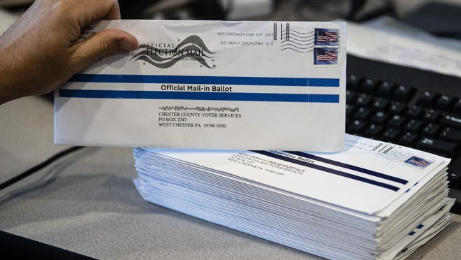 Mail-in primary election ballots are processed at the Chester County Voter Services office in West Chester, Pennsylvania, in May.