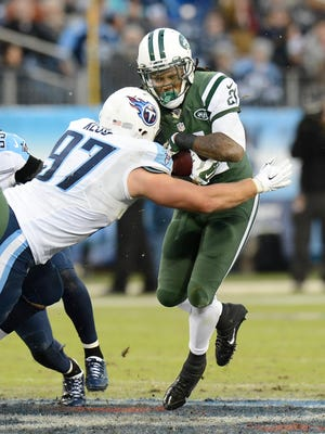 Jets running back Chris Johnson is hit by Tennessee defensive end Karl Klug in the second half Sunday.