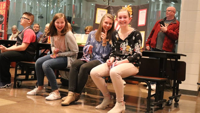 """Olivia Eickert, Kennedy Adkins and Marcella Brenner, eighth graders at Port Clinton Middle School, earned first place at the PCMS Young Entrepreneurs' Shark Tank for their business proposal, """"The Poppin' Movie Theater"""""""