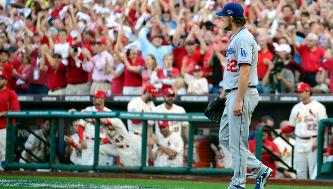 Clayton Kershaw reacts after David Freese scores the Cardinals' only run.