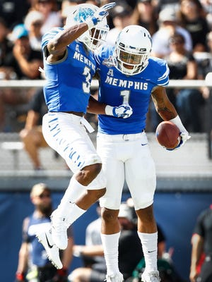 Memphis teammates Tony Pollard  (right) and Anthony Miller (left) celebrate his touchdown against the UCF defend during second quarter action of the the AAC Championship football game in Orlando, Fl., Saturday, December 2, 2017.
