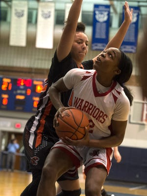 Susquehannock's Jaden Walker gets set to leap up for a shot, Wednesday, Feb. 13, 2018. The Central York Panthers beat the Susquehannock Warriors, 33-29 to advance to the YAIAA championships.