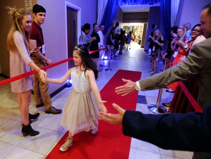 Addison Bortnick, 10, is greeted as she walks down