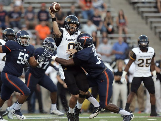 Southern Miss quarterback Nick Mullens is hit by UTEP linebacker Lawrence Montegut Saturday in the first half of their game at the Sun Bowl in El Paso, Texas.