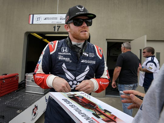 Dale Coyne Racing IndyCar driver Conor Daly (17) signs