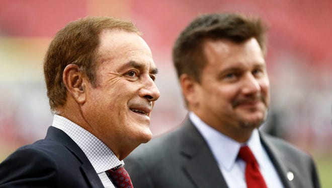 Sportscaster Al Michaels talks to Arizona Cardinals president Michael J. Bidwill before a preseason game at University of Phoenix Stadium in Glendale on Aug. 24, 2014.