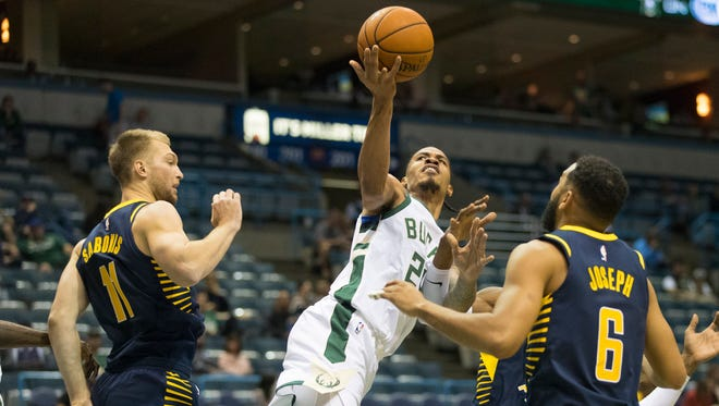 Bucks guard Gerald Green -- shooting between Indiana Pacers forward Domantas Sabonis (left) and guard Cory Joseph in an exhibition game -- was one of four players released Saturday.
