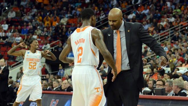 Tennessee guard Antonio Barton celebrates with coach Cuonzo Martin.