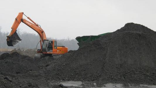 In this file photo, an excavator removes coal ash from the ash pond at Santee Cooper's Jefferies power generating station just outside Moncks Corner. Environmental Protection Agency officials, responding to a 2008 coal ash disaster in Tennessee and a spill last year in North Carolina, in December set new minimum requirements for storing and recycling the substance. But the agency did not create a new federal permitting program, instead leaving it to states to adopt the standards in their waste management plans.