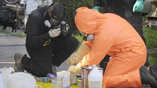 St. Clair County Drug Task Force and Port Huron Police go through items from a suspected meth lab on Friday, July 24, 2015, on Varney in Port Huron.