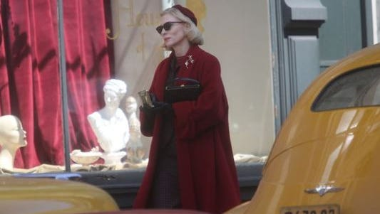 """Oscar-winning actress Cate Blanchett walks down Fourth Street during the filming of the movie """"Carol."""""""