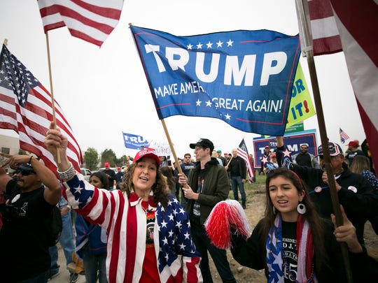 Jacqueline Hackney (left) and her daughter, Tiffany Hackney, 13, (right) both of Corona, Calif., cheer during a rally in support of President Trump a few miles from where he will visit the border wall prototypes near the Otay Mesa Port of Entry in San Diego, Calif., later in the day on Tuesday, March 13, 2018.