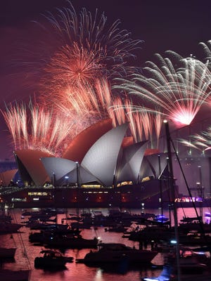 Fireworks light up the sky over Sydney's Opera House during New Year celebrations in Sydney on January 1, 2016.