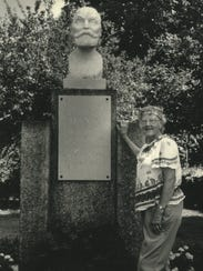 Emma Jungton of Pewaukee stands next to a statue of