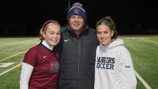 Westborough High girls soccer coach Paul Mumby (center) poses for a photo with his daugters Mia (left) and Emma prior to the Rangers' game against Shrewsbury at Westborough High School.