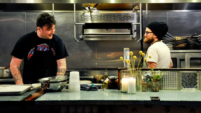 Milktooth chef Jonathan Brooks and chef Brandon Baltzley at the first CRUX dinner in January 2015 at Milktooth.