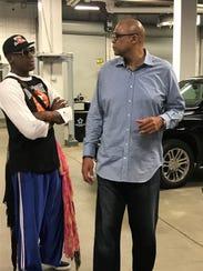Former Pistons teammates Dennis Rodman, left, and James