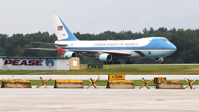 In this file photo from June 25, 2012, Air Force One lands with President Barack Obama at Pease Air National Guard Base in Newington, N.H.