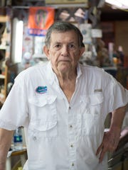 Tony Riha, owner of Esquire Barber Shop, stands for a portrait in his shop on Tuesday, April 11, 2017.