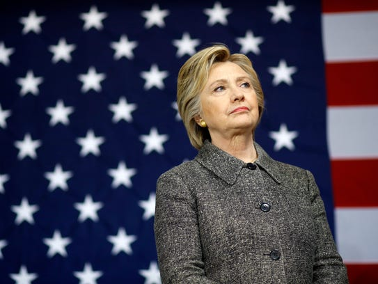 Hillary Clinton waits to be introduced during a campaign