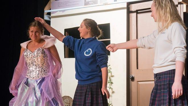 The Prince's henchman, Lord Pinkleton (Natasha Strzelewicz) pulls her sword on senile, old Crazy Marie (Kelly Gambino), who is really Ella's Fairy Godmother. Ella (Rachel Paulin) knows Marie is not a threat and protects her from Pinkleton's threat.