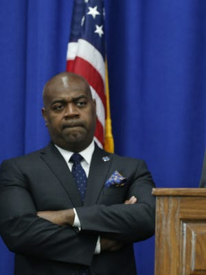 Newark Mayor Ras Baraka (left) listens as then-NJDEP commissioner Bob Martin speaks. Elevated levels of lead caused officials in New Jersey's largest school district to shut off water fountains in 2016.