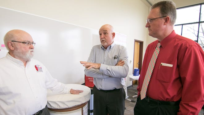 Terry Murray, center, chairman of the Livingston County Community Alliance, talks with Joe Carney, left, former chair, and Livingston County Sheriff Mike Murphy at an event Thursday, Nov. 30, 2017, commemorating the Alliance's collection of 10,000 pounds of turned in unwanted pills.