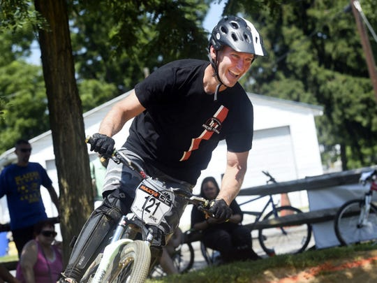 Todd Bauer takes a run at the pump track race event