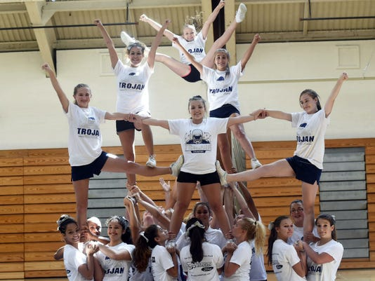 The Cambersburg Trojan Cheerleaders practice Tuesday for the upcoming football season at Chambersburg Area Senior High School.