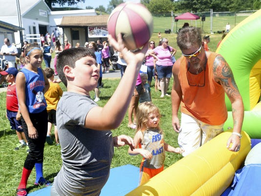 Ryan Blackwell — Public Opinion Matteo Rinaldo, 10, shoots some hoops Saturday during the 2nd Annual Family Fun Day at the Shippensburg Community Fairgrounds.