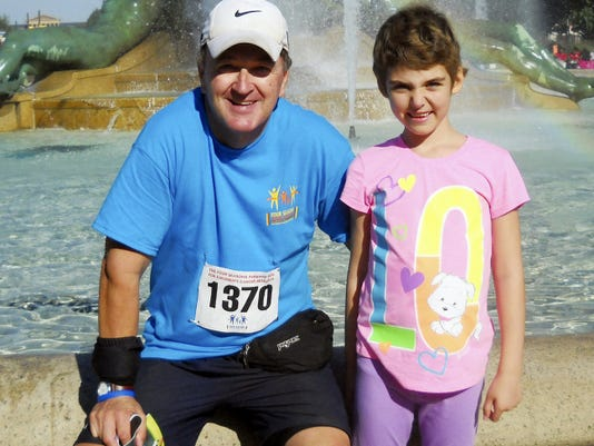 Tom Garrett of North Londonderry Township poses with Emily Whitehead in this file photo for 2012. Garrett is hosting the Blood Sweat and Tears Five Miler, which benefits the Leukemia and Lymphoma Society and the Emily Whitehead Foundation.