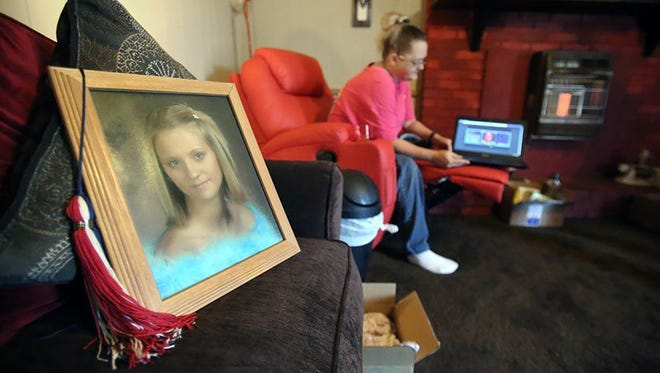 Lisa Chambers of Courtland, Miss., in the background, has waited nearly three years for justice in the murder of her 19-year-old daughter, Jessica Chambers.